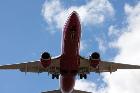 arrive: boeing 737 airplane near airport for landing