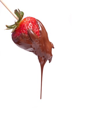 dipping: a strawberry dipped on chocolate with white background