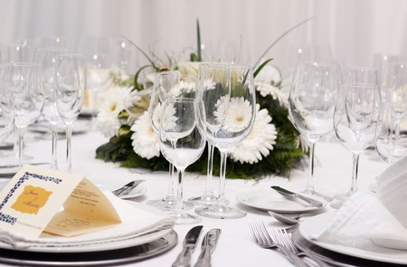table set for wedding celebration with glass and flowers Stock Photo