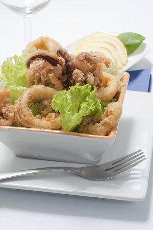 deep fried calamari with letucce and lemon Stock Photo - 4655479