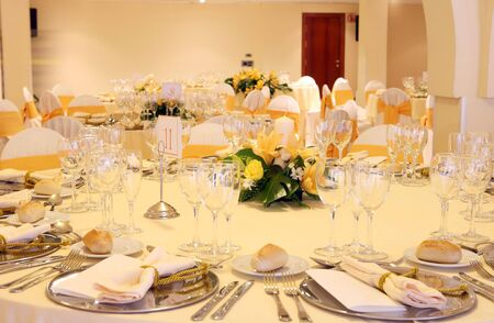hotel hall: wedding reception area ready for guests and the party on yellow colors Stock Photo