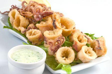 deep fried calamari with salad and butter sauce
