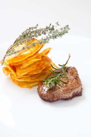 two juicy beef steak with chips and herbs Stock Photo - 8697653