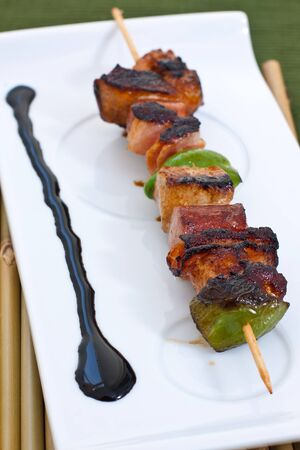 grilled meat on a skewer ready for eat photo