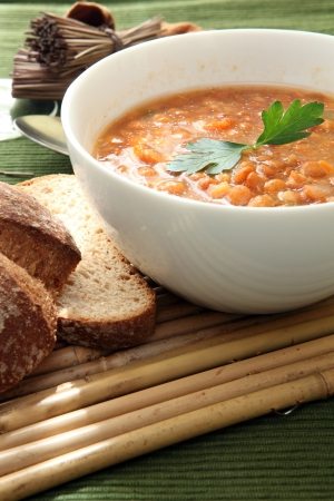 a white bowl of red lentil soup photo