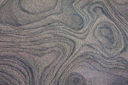 Wellen und Kurven auf Wüste Sand Textur Standard-Bild
