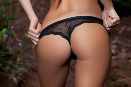 sexy young woman back with black lingerie Stock Photo