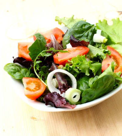 fresh lettuce and tomato salad on bowl Stock Photo