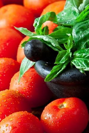 fresh tomatos and basil on wooden background photo