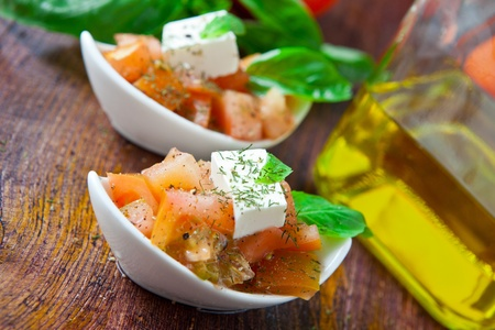 fresh tomato salad with mozarella cheese and basil photo