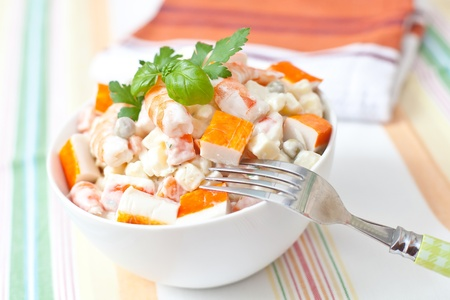 crab meat: surimi and prawn salad with potato and sauce