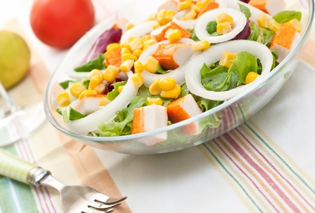 crab meat: surimi salad with fresh corn on glass bowl