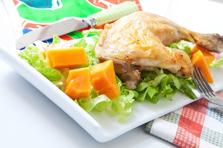 potatoe: chicken legs with vegetables and fruit on platter