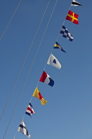 nautical flags on rope in a perfect blue sky photo