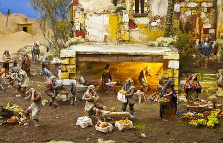 bible shepherd: Nativity scene from figurine crib with focus on farmers Editorial