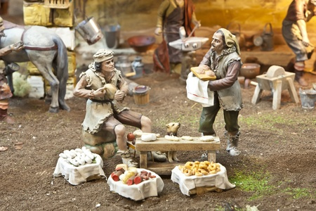 Nativity scene from figurine crib with focus on farmers