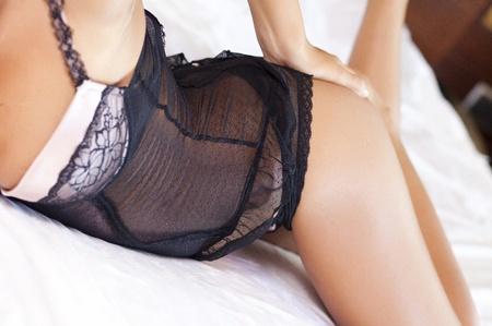black lingerie: woman back with black  lingerie on bed