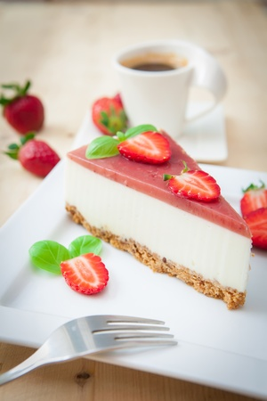 a piece of strawberry cheesecake on white tray photo