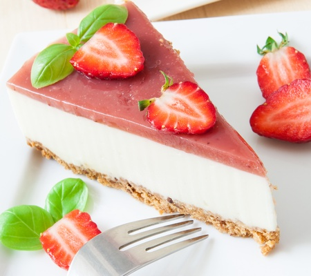 strawberry cake: a piece of strawberry cheesecake on white tray with coffee cup Stock Photo
