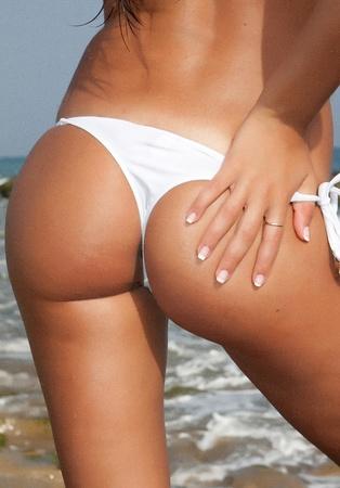 woman back with colorful bikini on beach Stock Photo