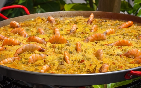 traditional spanish paella with prawn on  big pan