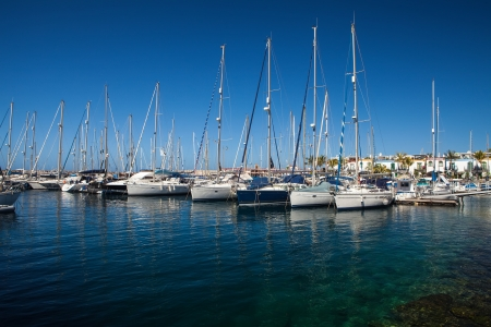 marina view with luxury boats and yacht photo