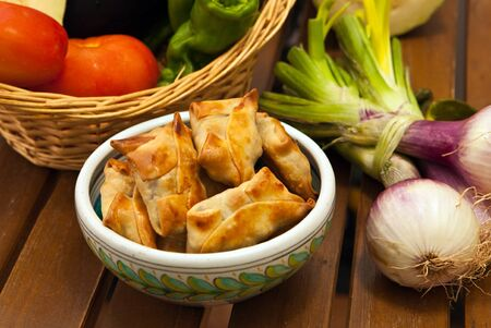 non vegetarian: fried beef samosas with vegetables on basket Stock Photo