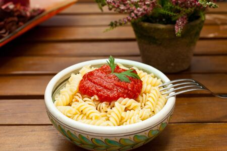 italian style pasta with tomato sauce and parsley photo