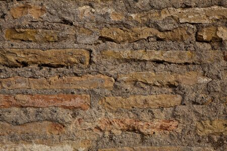 mud wall: old red mud brick wall in spain Stock Photo