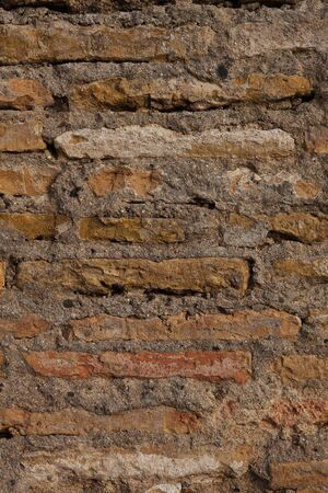 old red mud brick wall in spain photo