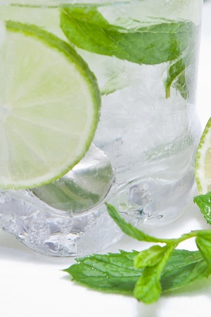 mojito cold cocktail served with mint and lime