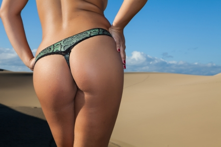 perfect young women back on beach with panties Stock Photo