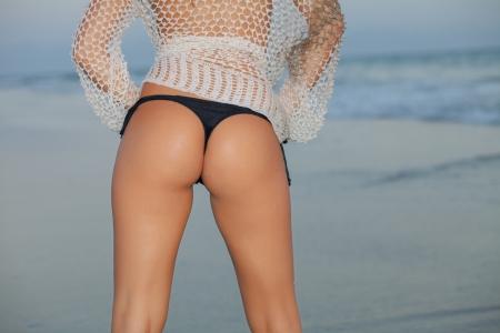 young beautiful woman back with bikini on beach Stock Photo