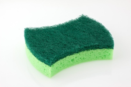 scour: A new, clean and colorful  green scrubber pad or scourer Stock Photo