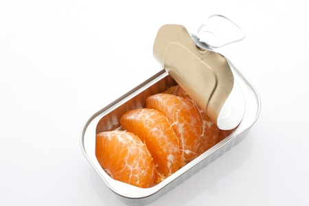 manderin orange in a silver can on white background Stock Photo - 17776278