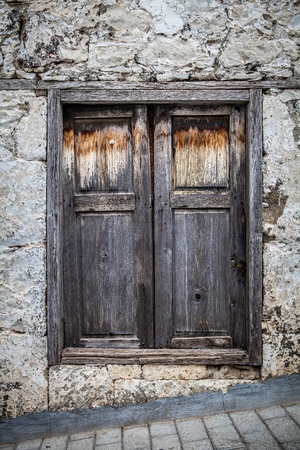 old wood small door on brown and grey colors photo