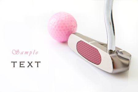 Golf putt and pink ball in white background photo
