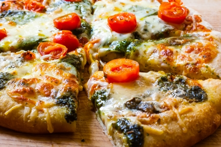 meat lover: a hot and fresh slice of mozarella and cherry tomato