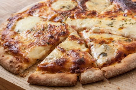 homemade  four cheese pizza on wooden board photo