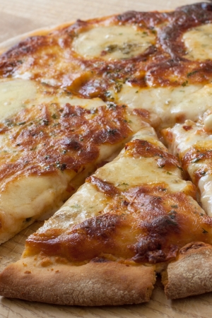 meat lover: homemade  four cheese pizza on wooden board Stock Photo