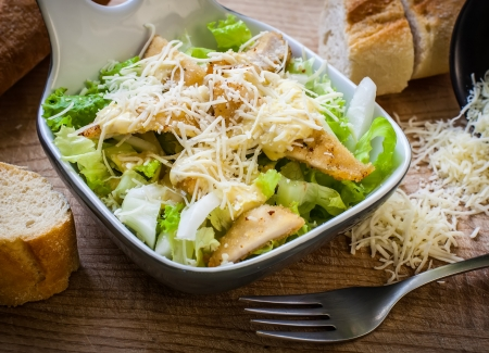 salad dressing: fresh caesar salad on bowl with parmesan cheese Stock Photo