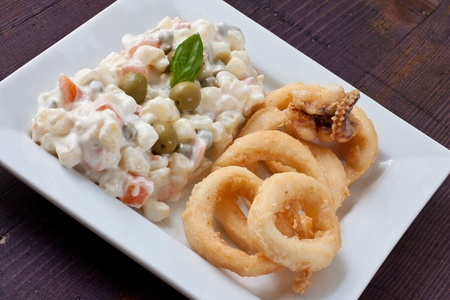 fried calamari and russian salad on white tray photo