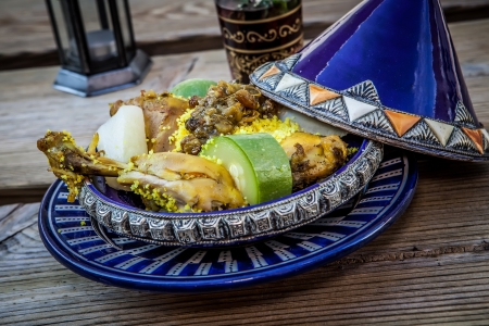 moroccan cuisine: moroccan food chicken tajine with vegetables and tea Stock Photo