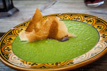 traditional green pea soup from morocco served on plate