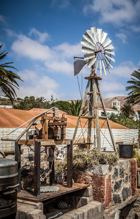 Old antique Aermotor windmill used to pump water for cattle on a ranch  Stock Photo