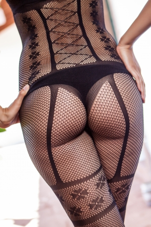 young woman perfect ass with black lingerie photo