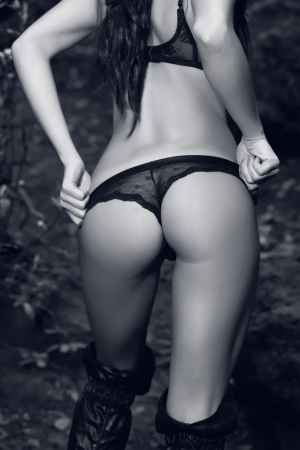 woman back with black lingerie on forest photo