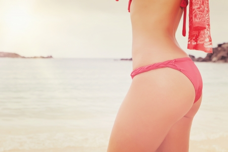 woman back with red bikini on beach photo