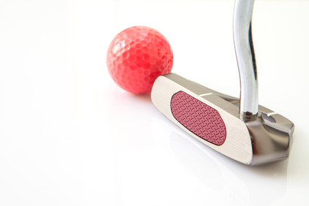 putter: Golf putt and red ball in white background Stock Photo