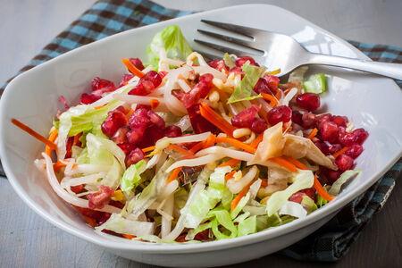 pomergranate: white bowl with fresh pomergranate salad and lettuce